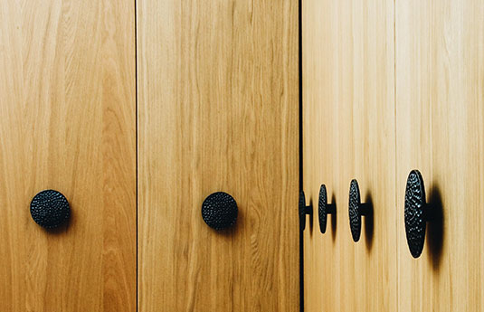 Du Veere door pulls on a wood cabinet