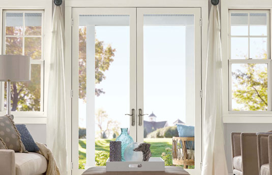 Double french doors in a home with a view