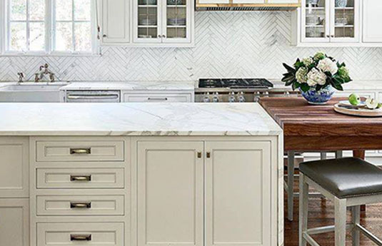 kitchen cabinets featuring Atlas Homewares decorative hardware