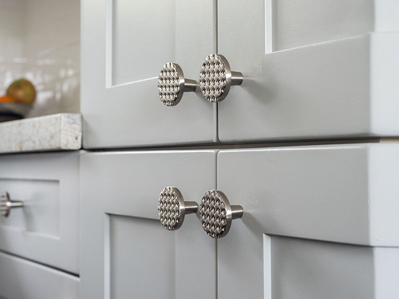 cabinet featuring Du Veere decorative hardware