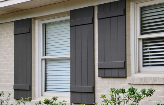 Board and batten shutters on a home